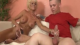 Horny granny jacks off a dude